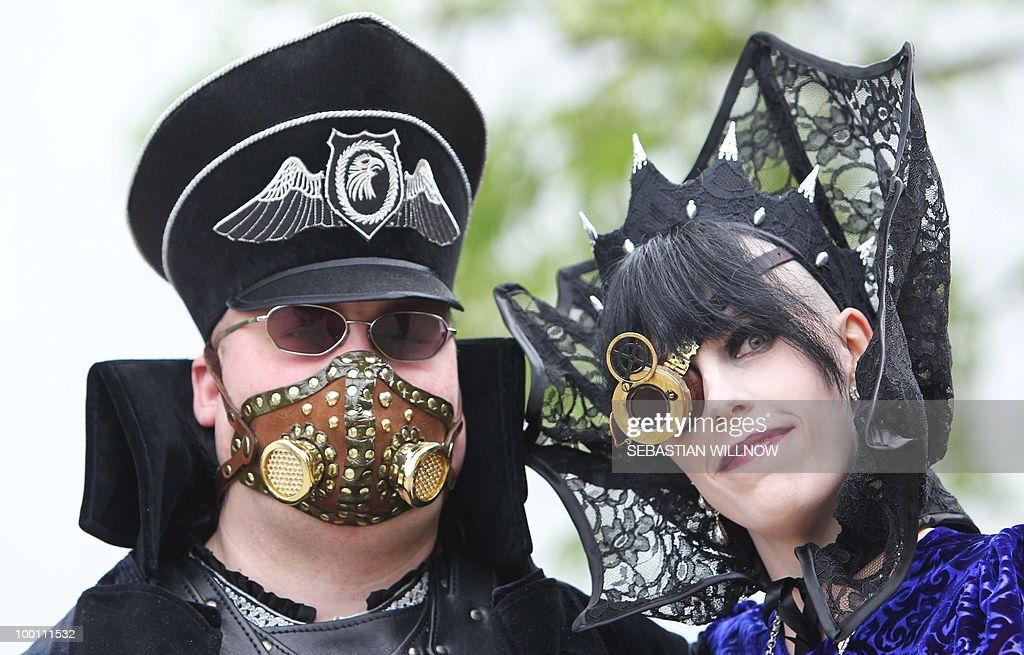Participants in an annual Wave-Gothic festival pose on May 21, 2010 in Leipzig, eastern Germany, where more than 20 000 people are expected to attend the festival attracting the friends of gothic romanticism. The festival offers a very special spectacle with a range of concerts, historical markets, theatre and cinema, gothic scene performances, exhibitions, readings and parties.