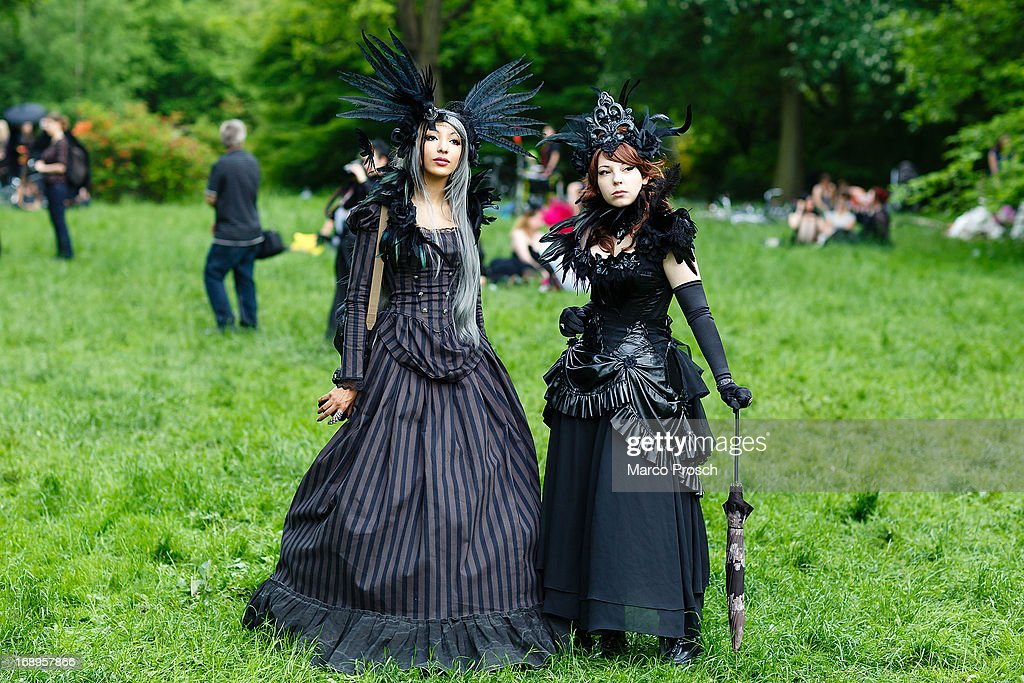 Participants in black clothing and feather-hats pose for pictures during the traditional park picnic on the first day of the annual Wave-Gotik Treffen, or Wave and Goth Festival, on May 17, 2013 in Leipzig, Germany. The four-day festival, in which elaborate fashion is a must, brings together over 20,000 Wave, Goth and steam punk enthusiasts from all over the world for concerts, readings, films, a Middle Ages market and workshops.