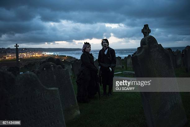 TOPSHOT Participants in costume attend the biannual 'Whitby Goth Weekend' festival in Whitby northern England on November 6 2016 The festival brings...