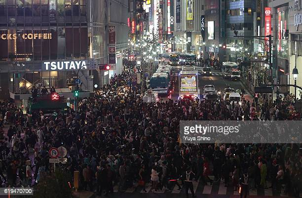 Participants in costume cross a street during Halloween celebration at Shibuya district on October 31 2016 in Tokyo Japan