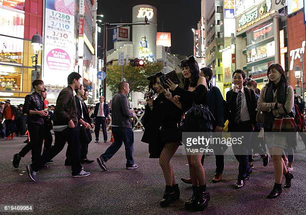 Participants in costume cross a street during Halloween celebrations at Shibuya district on October 31 2016 in Tokyo Japan