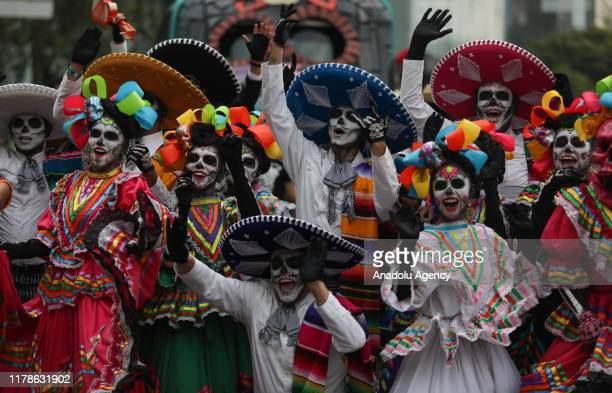 Participants in costume perform during the annual International Day of the Dead Parade in Mexico City Mexico on October 27 2019 The idea for the...