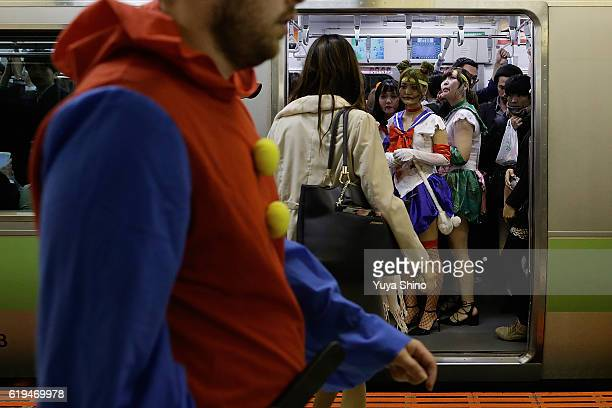 Participants in costume ride on a train after Halloween celebrations at Shibuya district on October 31 2016 in Tokyo Japan