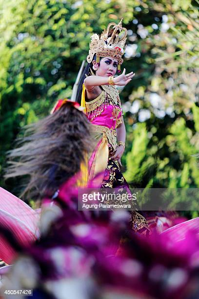 Participants in costumes dance during the opening of the 36th Bali International Arts Festival on June 13, 2014 in Denpasar, Bali, Indonesia. The...