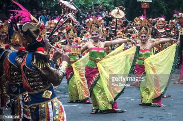Participants in costumes dance during the opening of the Bali International Arts Festival on June 15 2013 in Denpasar Bali Indonesia The annual...