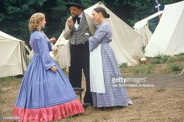 Participants in full costume in camp scene during recreation of Battle of Manassas Virginia