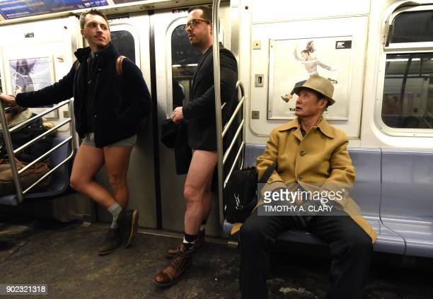 Participants in the 17th Annual 'No Pants Subway Ride' travel in the New York City subway on January 7 2018 in New York The 'No Pants Subway Ride' is...