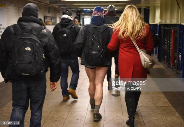 "Participants in the 17th Annual ""No Pants Subway Ride"" travel through a New York City subway station on January 7, 2018 in New York. The ""No Pants..."