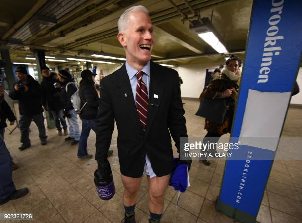 Participants in the 17th Annual 'No Pants Subway Ride' travel through a New York City subway station on January 7 2018 in New York The 'No Pants...