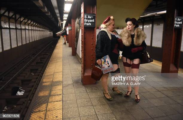 "Participants in the 17th Annual ""No Pants Subway Ride"" wait for a New York City subway train on January 7, 2018 in New York. - The ""No Pants Subway..."