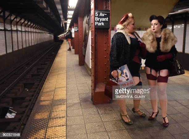 Participants in the 17th Annual 'No Pants Subway Ride' wait for a New York City subway train on January 7 2018 in New York The 'No Pants Subway Ride'...