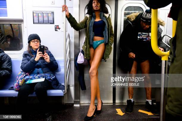 "Participants in the 18th Annual ""No Pants Subway Ride"" travel in the subway on January 13, 2019 in New York. - The ""No Pants Subway Ride"" is an..."