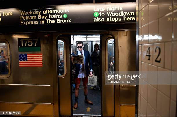"Participants in the 19th Annual ""No Pants Subway Ride"" travel in the subway on January 12, 2020 in New York. - The ""No Pants Subway Ride"" is an..."