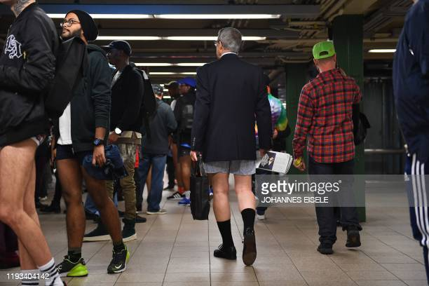 "Participants in the 19th Annual ""No Pants Subway Ride"" wait to board a train in the subway on January 12, 2020 in New York. - The ""No Pants Subway..."