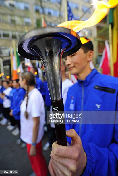 Participants in the 2010 World Harmony Run hold torches and flags, at the start of the worldwide relay in New York, April 12, 2010. Founded in 1987...
