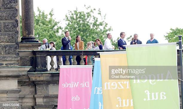 Participants in the 2016 Bilderberg conference sighted on the balcony of the Dresden Opera House or 'Semperoper' during a group tour on Saturday...