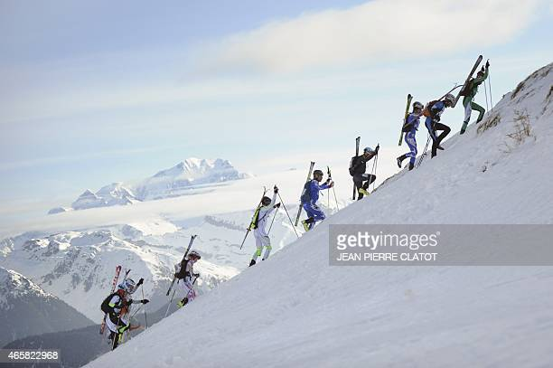 Participants in the 30th edition of the PierraMenta skiclimbing race climb Antecime peak at 2651m during the first stage of the race on March 11 2015...