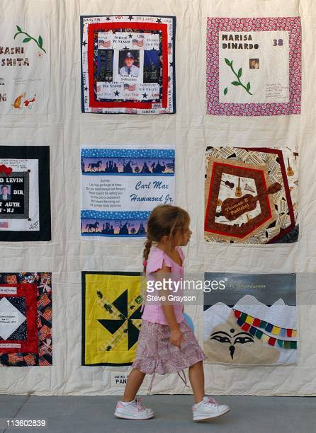 Participants in The 9/11 United In Memory Quilt Unveiling and Ceremony view panels of the quilt on display at the Pacific Design Center in memory of...