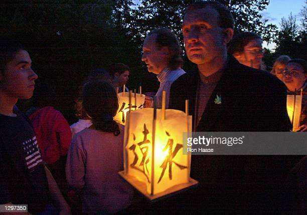 Participants in the annual 'From Hiroshima to Hope' lantern floating ceremony watch their candle lit lanterns float away on Green Lake The ceremony...