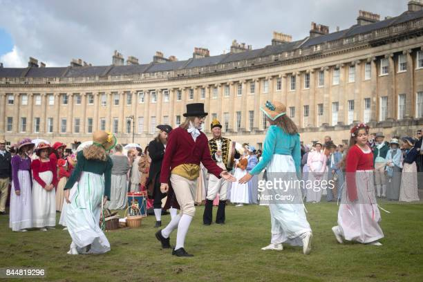 Participants in the annual Jane Austen Regency Costumed Parade dance on the lawn of the historic Georgian Royal Crescent before they walk through the...