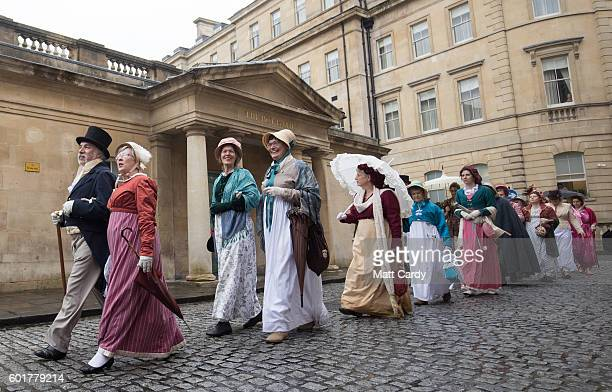Participants in the annual Jane Austen Regency Costumed Parade pass the Thermae Bath Spa on September 10 2016 in Bath England The annual event sees...