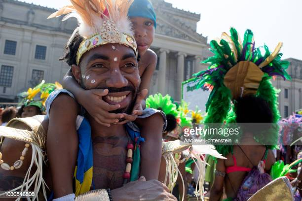 Participants in the annual West Indian Day Parade dance down Eastern Parkway on September 3, 2018 in Brooklyn, New York.