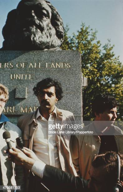 Participants in the BBC television programme 'Students in Revolt' pose by Karl Marx's tomb in Highgate Cemetery London 12th June 1968 From left to...