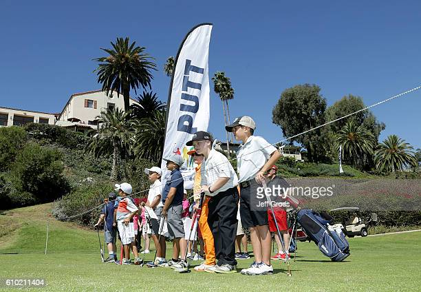 Participants in the boys 79 division wait to putt in the putting competition during a regional round of the Drive Chip and Putt Championship at...