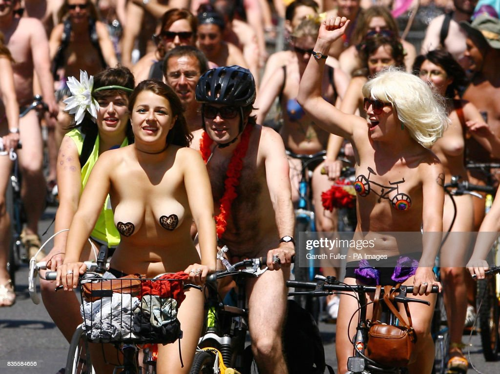 Participants in the Brighton leg of the World Naked Bike Ride move through the streets of Brighton, East Sussex to demonstrate the vulnerability of cyclists on the road and is a protest against oil dependency.