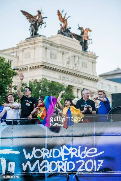 Participants in the celebrations of the World Pride 2017 in a carriage in the streets of Madrid Spain