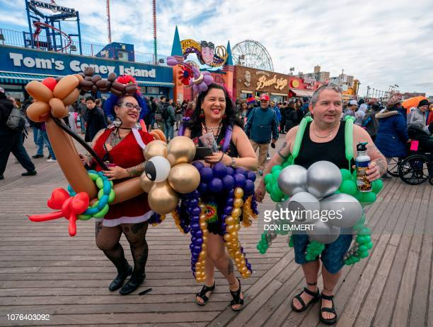 Participants in the Coney Island Polar Bear Club's annual New Year's Day Plunge stroll the boardwalk before going for a swim January 1 2019 on Coney...