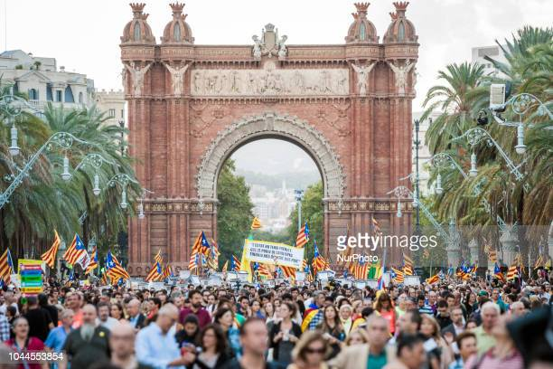 Participants in the demonstration in Barcelona for the one year anniversary of catalan elections for independence on 1st of october of 2017 carry...
