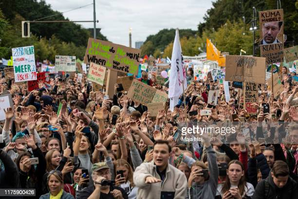 Participants in the Fridays For Future movement protest during a nationwide climate change action day in front of the Brandenburg Gate on September...