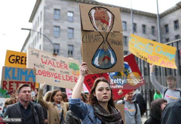 Participants in the Fridays For Future movement protest outside the Federal Ministry of Finance during a nationwide climate change action day on...