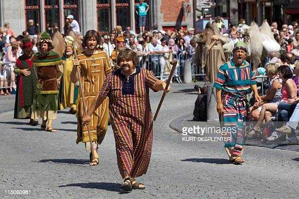 Participants in the Holy Blood Procession walk in Bruges' Grand Place on the Ascension Day June 2 2011 During the procession a relic of holy blood is...