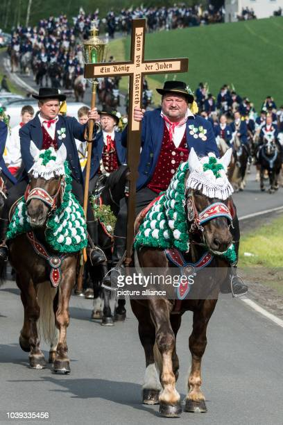 Participants in the Koetzing Pentecost Ride ride their horses near Bad Koetzing Germany 16 May 2016 The procession of 900 horsemen is one of the...