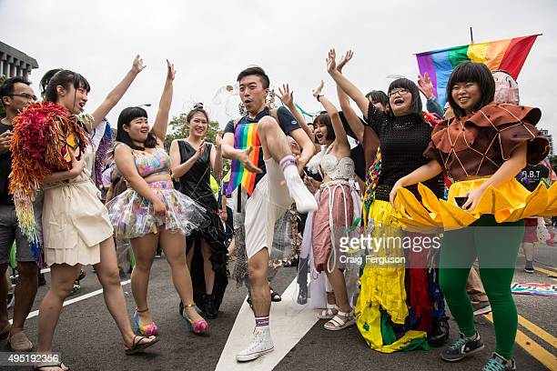 Participants in the LGBT Pride parade came with rainbow clothes costumes and sometimes not much as all as they took to the streets in a show of...