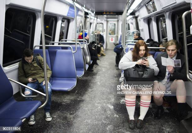 Participants in the No Pants Subway Ride DC, ride on the metro on January 7, 2018 in Washington, DC. The No Pants Subway Ride is an annual event...