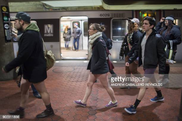 Participants in the No Pants Subway Ride DC, walk through the a Metro station on January 7, 2018 in Washington, DC. The No Pants Subway Ride is an...