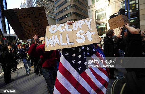 "Participants in the ""Occupy Wall Street"" demonstrate around Wall Street attempting to disrupt pedestrian flow for financial workers to get to work,..."
