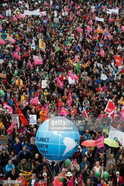 Participants in the protest wave against the G20 Summit demonstrate at the Rathausmark in Hamburg, Germany, 02 July 2017. About 4000 people gathered...