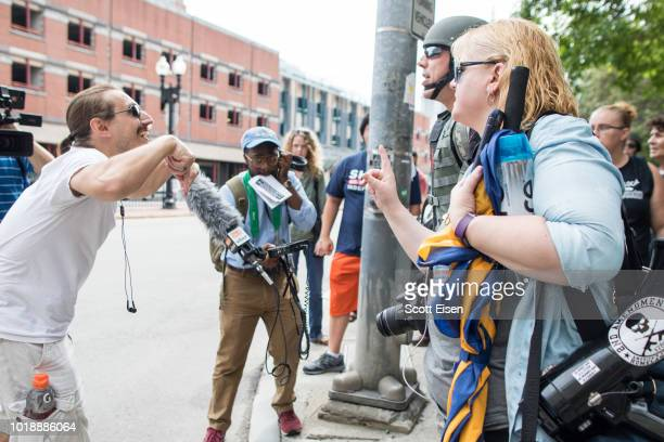 A participant of the 'Boston Free Speech Anniversary March Against FarLeft Violence' speaks into a megaphone at City Hall Plaza on August 18 2018 in...