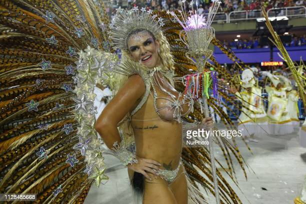 Participants in the samba school parade Renascer Of Jacarepagua during the presentation of the samba schools of group A at Sambodromo da Marques de...