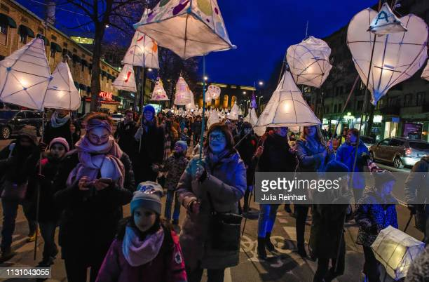 Participants in the UN World Day for Social Justice carry handmade lanterns through the streets on February 20 2019 in Gothenburg Sweden