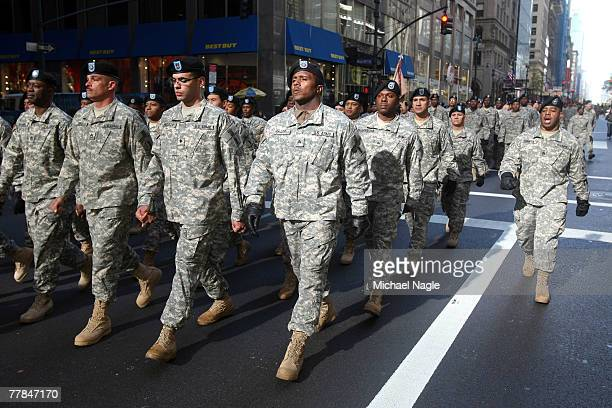 Participants in the Veterans Day parade march up Fifth Avenue on November 11 2007 in New York City Veterans Day is the anniversary of the Armistice...