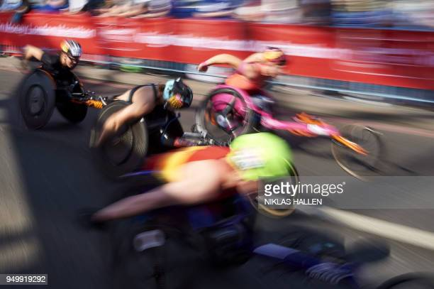 Participants in the wheelchair race race during the 2018 London Marathon in central London on April 22 2018