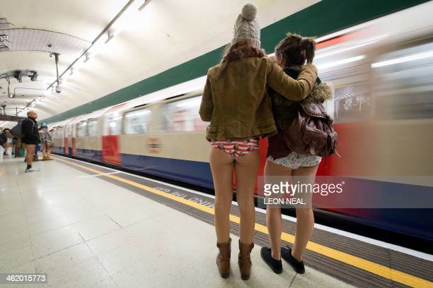"Participants in the13th annual International ""No Pants Subway Ride"" wait for trains at a London underground station in London, on January 12, 2014...."