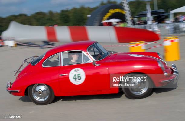 Participants in their Porsche 356 S car built in 1962 take part in the 3rd Elbflorenz Rally on the premises of the company Vestas in Lauchhammer...