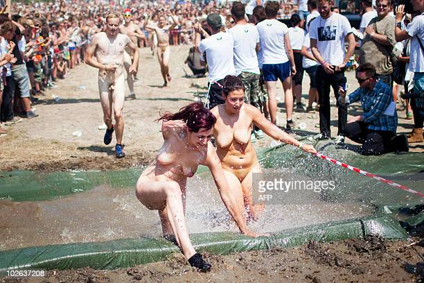 Participants in this year's nude run compete at the Roskilde Festival on July 3 2010 Only the first 30 festival men and women are allowed to rush...