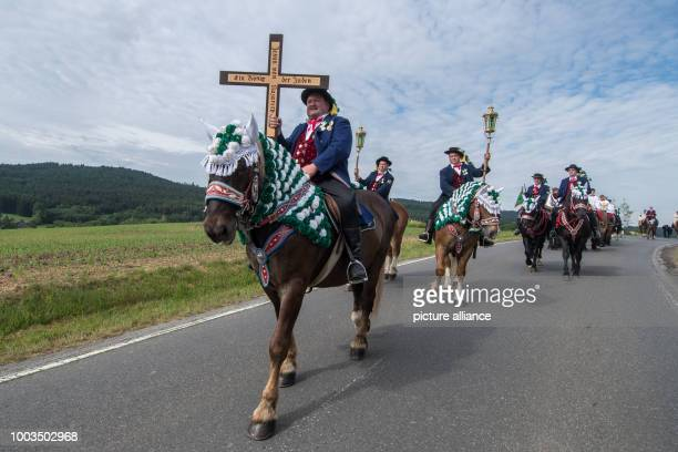 Participants in traditional Whitsun celebrations ride horses during a mounted procession near Bad Koetzing Germany 5 June 2017 Around 900 riders took...